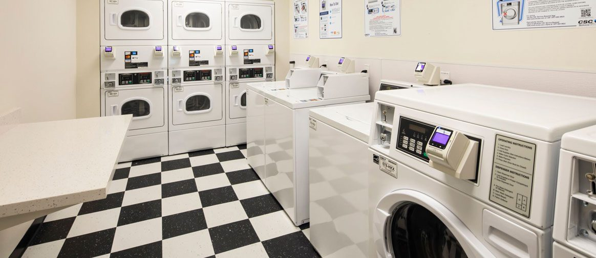 24/7 guest laundry room with white and black checkered floor