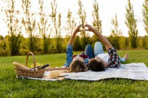 A couple having a picnic lunch on Valentine's Day