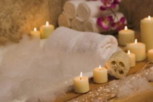 A bubble bath set up with candles to treat yourself this Valentine's Day.